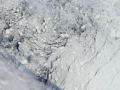 An image of an area of the Arctic sea ice pack well north of Alaska, captured by the MODIS instrument on NASA's Aqua satellite on Sept. 13, 2013, the day before the National Snow and Ice Data Center estimated Arctic sea ice to have reached its minimum extent for the year. A cloud front can be seen in the lower left, and dark areas indicate regions of open water between sea ice formations. —Credit: NASA