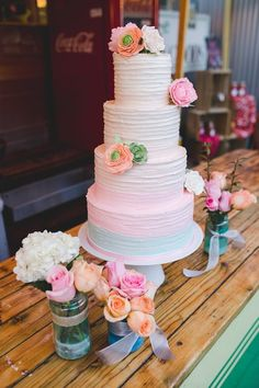 Spring wedding cake idea - four-tier wedding cake with ombré, buttercream-frosting + flower details {Aaron Kes Photography}