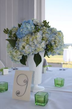 blue hydrangeas in milk glass - gotta find out what that extra greenery is called, LOVE it!