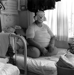 A patient who has been hospitalized in a mental hospital in Japan for years sits before Hasselblad.  by Shinya Ichikawa