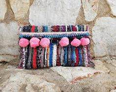 Santorini Clutch Bag  Twininas handmade Santorini rug patchwork clutch bag adorned with fabric lace and pink pom poms. Has one main pocket and a button