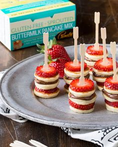 Need brunch recipes? These make ahead Gluten-Free Mini Pancake Skewers couldn… Need brunch recipes? These make ahead Gluten-Free Mini Pancake Skewers couldn't be simpler and they look adorable on the buffet table. Pamela's Gluten Free Sprouted Pancak Köstliche Desserts, Dessert Recipes, Pancake Recipes, Party Recipes, Bacon Pancake, Birthday Recipes, Allrecipes Desserts, Holiday Recipes, Buffet Recipes