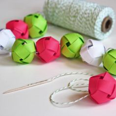 Make a garland from woven paper balls . Not really Origami but really cute paper craft made out of paper strips similar to Origami Lucky Star Paper :) Paper Christmas Decorations, Paper Ornaments, Christmas Paper, Homemade Christmas, Paper Garlands, Ball Decorations, Ball Ornaments, Butterfly Ornaments, Christmas Garlands