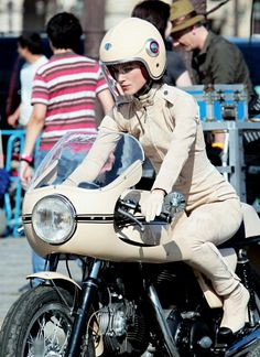 Kiera Knightly for Chanel Ducati 750SS.  This gets a re-pin 'cause it's an old bevel-drive Ducati. But Keira is wearing the dumbest looking motorcycle outfit ever. Hard to believe she could look bad in anything, but here is proof. I wouldn't let her on my Triumph wearing that. As for #Chanel: don't try to mix fashion and motorcycles again as you're clearly lost here.