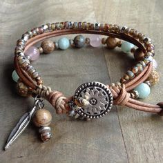 This gemstone bracelet is made with, Rosequartz beads, Amazonite beads, Picture jasper and Impression jasper ,leather miyuki beads a feather charm and a metal button. Fits a wrist of 18 cm = 7.08 inch. Please read my policies before ordering.