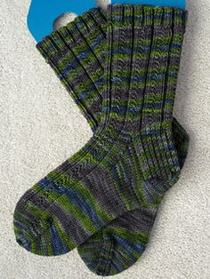"""I designed this sock pattern based on one of my favorite stitches for socks. I can't recall where I first saw this stitch or if """"skyp"""" was the actual abbreviation that was used. All I do know is that I love this stitch, the abbreviation makes sense to me and I have been using them both for years."""