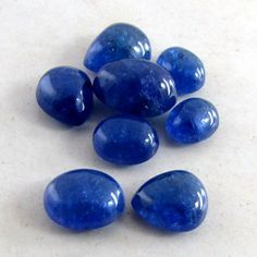 4.25-13.85carat - Tanzanite Mixed Shape Cabochon Parcel