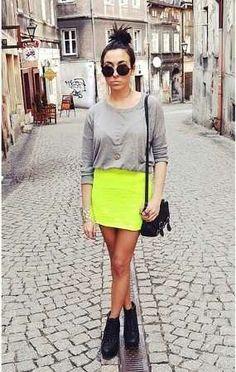 neon skirt, grey shirt, black boots, black bag, sunglasses, bun