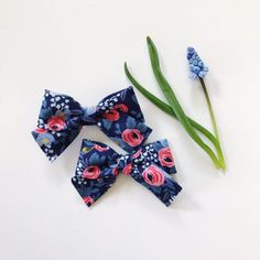 EverIrisDesigns Mini School Girl Bow Flora Dark Blue with Nylon band or hair clip, pigtail set, newborn headbands, baby girl headbands, floral bows, sets, Rifle Paper fabric bows, Rifle Paper Headbands, nylon headbands, baby girl headband, newborn headband, infant headbands, baby accessories, baby bows, baby girl shower gift, stretchy headband, ever iris, everiris, it's a girl, its a girl, skinny nylon band, etsy, for girls, boutique, girl favor, girl birthday