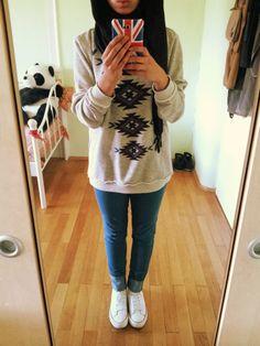 regular sweater w/ jeans and converse. black hijab.