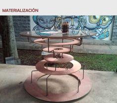 """Café de Guacamayas es un proyecto realizado para lugares de esparcimiento de la ciudad, como museos, plazas y parques. Está inspirado en los tejidos de fiqué realizados por la comunidad de Guacamayas, a esto se deben sus aros que van unidos y soportados por la estructura central, esto haciendo semejanza a la manera de trenzar la paja con el fiqué y ajustarlos a cada vuelta del tejido.  *Nominado en la categoría """"Mejor Diseño Conceptual"""" de los Premios Diseño y Punto 2012"""