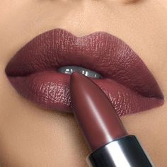 There is something to be said about a lip color that is truly gorgeous, yet understated. I designed this earthy matte shade with a 90's Fall/Winter Fashion Show season in mind, where almost all the different designers had us walk down the runway in this beautiful, rich mauve color. It's basically a dark nude, the quintessential 90's shade, because you can pair it with a dark smoky eye, or complement it with a nude palette. If you want to glam it up and giv #LipstickColors Mauve Matte Lipstick, Lipstick Art, Lipstick Dupes, Dark Lipstick, Best Lipsticks, Lipstick Colors, Lip Colors, Maroon Lipstick, Berry Lipstick