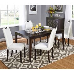 Create a beautiful interior dining space with the stylish and contemporary wenge finished dining table and unique white upholstered faux leather parson style chairs.
