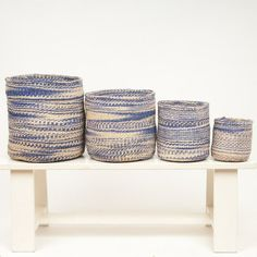 A beautiful purple cloud basket design available in five sizes. Designed in-house by The Basket Room and handwoven by a member of the womens weaving cooperatives in rural South Western Kenya. Woven from the sisal plant, each basket goes through a detailed process, from growing, to harvesting, rolling, dyeing and finally weaving. Ideal for use as a stylish storage basket, bringing a rustic & natural look to your home. Use the smaller sizes in the bathroom or bedroom and the larger for toy…