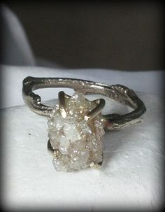 I think this is my favorite. Huge raw diamond engagement ring white gold and by EarthDiamond