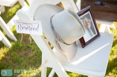 The brides father had passed before the wedding. His hat and a photo of him was placed on a front row seat for the ceremony along with the note: Reserved