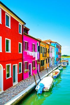 Burano Island, Italy! Click through to see some of the most colorful cities in the world! This post does not contain industrial soot stained cities; instead it showcases some of the most vibrant looking cities in the world.