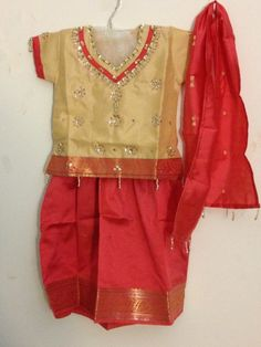 Coral & beige silk pattu pavada outfit for kids.