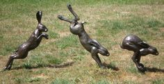 Bronze or marble resin Wild Animals and Wild Life sculpture by artist Christine Close titled: 'Harespeed (Amusing White or Brown Hares Yard or garden sculptures)'