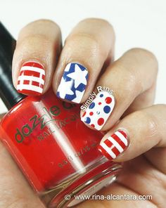 This classic stars and stripes mani from Simply Rins is perfect for the upcoming Independence Day. Click here for 15 fun, patriotic 4th of July nail looks! #fourthofjuly #nails #nailart