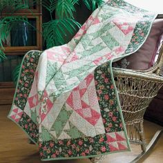 MAY FAIR: Repeating Block Lap Quilt Pattern Designed and machine quilted by MARIA UMHEY Pink diamonds and green diagonal bars appear when 1 basic patchwork quilt block design is set together into rows for this pretty, feminine quilt. May Fair looks complex, but construction is actually sew easy! Pattern in the July/August 2016 issue of McCall's Quilting