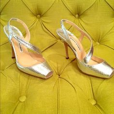 Manolis Blanik Silver Peep Toe Pump Authentic Manoli Blanik (with box and sleeper bags). Size EU 38, but fits US 7 to 7.5. Will NOT fit US 8. Beautiful silver pump only worn three times. Snakeskin pattern. No wear except for bottom sole (as shown in photo). Manolo Blahnik Shoes Heels