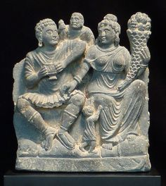 PANCIKA AND HARITI. Gandhara, 1st-2nd century AD. 9.5 h x 8 w inches. Carved in grey shist.