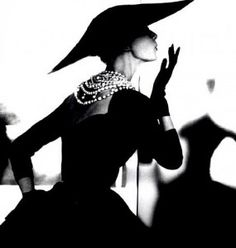 Glamorous Lillian Bassman  Wearing the jewellery on the back of the neck like Coco Chanel.  Love the gloves.