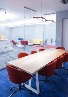 Haven Interior Design: Heatworks  - Modern Office - Conference Room - Custom Conference Table - Modern Conference Chairs - Blue Carpet - Custom Carpet Design - Milliken - Carpet Tile - Light Fixture - Office Interior Design - Glass Walls - Tech Office (Photo by Leslie McKellar)
