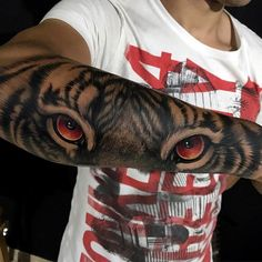 Tiger tattoo, tiger eyes tattoo, mirada de tigre, tatuaje de tigre, tigre tatuaje en antebrazo, los mejores tatuajes de tigres, tigre realista tatuaje, manizales, juan david rendon, tatuajes colombia.