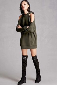A pair of over-the-knee sock boots from LFL By Lust For Life™ featuring a round toe, chunky stacked heel, a side zipper, faux leather stripes framing the trim, and an elasticized back panel for comfort.