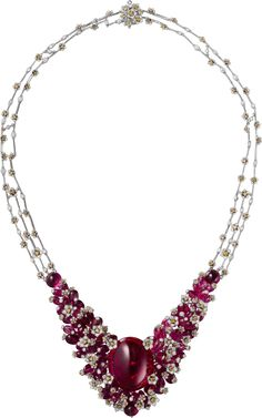 CARTIER. Necklace - white gold, one 62.15-carat oval-shaped cabochon-cut rubellite, three cabochon-cut rubellites totaling 9.90 carats, rubellite beads, orange and white brilliant-cut diamonds.