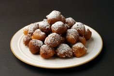 These baci di ricotta -- perfect kisses, hot, soft and melting -- are a surprisingly easy dessert. It's just a question of mixing the ingredients in a bowl (by hand) and then frying rounded teaspoonfuls of the batter in just under an inch of oil until you have some light, small, vaguely ball-shaped fritters that need no more than a powdery dusting with confectioners' sugar. (Photo: Jonathan Player for The New York Times)