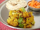 Sukhi Aloo Gobhi Sabzi Recipe Curried spiced cooked cauliflower dish from Northern India