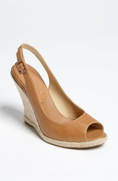 Every year I try to find a pair of sandals I can practically live in. I have Croc flips, black Clark wedges and I am thinking THESE could be my saddle colored sandals.
