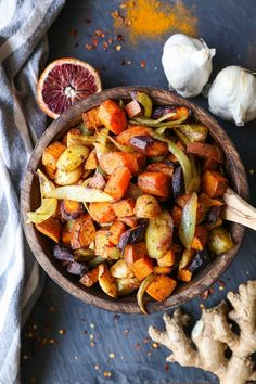 Orange Ginger Turmeric Roasted Root Vegetables. 1 large turnip, 1 bunch of carrots, 1 large sweet potato, 1 bulb garlic, 1/4 cup olive oil, 2 tbsp vinegar, 1 tbsp maple syrup, 2 tsp orange zest, 1 tbsp ginger, 1/4 tsp ground turmeric, 1 tsp salt.
