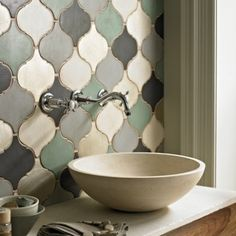 Love the Marrakech tiles and this stone vessel bathroom sink