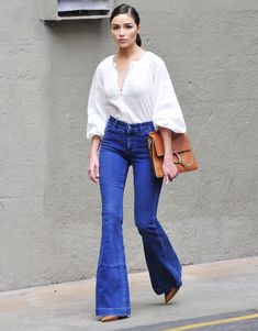 Olivia Culpo just wore the ultimate affordable white blouse from H&M. Shop it before it's gone.