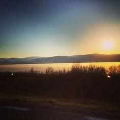 Frozen lake, midnight sun. Road to Riksgransen from Kiruna, Sweden.