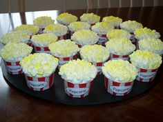 I made these for Madi's carnival birthday and they were great! Just cut a cross into the bottom half of each marshmallow, squish slightly, and place on icing. Spray with yellow cake mist to look like buttered popcorn.
