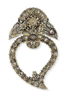 An 18th century diamond brooch The openwork stylised heart surmounted by a floral bouquet, set with old brilliant and rose-cut diamonds in closed-back settings, mounted in silver, pierced and engraved decoration throughout, traces of gilding to reverse, length 6.2cm.