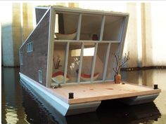 This eco-friendly houseboat makes me miss Amsterdam. I will retire there; I swear it.