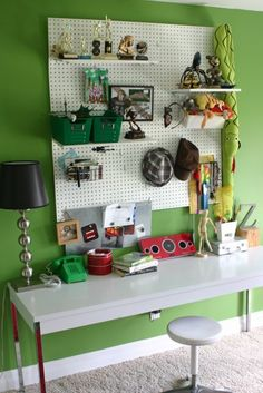 small thin desk with peg board at top - get different holders to store his work bench tools, tape, wire, etc.