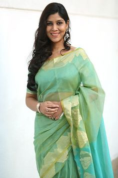 We're all about this seafoam green shade on Sakshi Tanwar. #refinery29 http://www.refinery29.com/sari-outfits#slide-22
