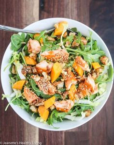 Asian Salmon Arugula Napa Cabbage Mango Salad with Candied Walnuts - this salad is deliciously light and hearty enough for a main course salad