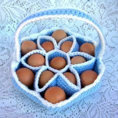 "This is the perfect accessory for the chicken enthusiast! I designed this egg carrying basket to hold 13 eggs safely in their own cushy compartments where they won't get broken.Made with acrylic yarn, this basket is durable and washable if your eggs are so fresh that there's still a little...you know what...on them. Each egg cup has a circumference of about 5.5"" and will fit large chicken eggs."