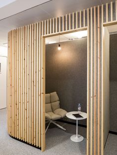 How to make a design impact using simple pieces of wood for office Interior Design. Paris office insurance company headquarters.