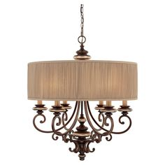 Elegantly illuminate your foyer or dining room with this eye-catching chandelier, featuring a champagne bronze finish and lovely scrollwork design.