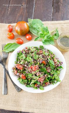 This quick and simple tomato spinach quinoa salad is such an easy side dish that's ready in just minutes. Full of fresh ingredients and an easy homemade dressing. Gluten free, vegan, paleo and whole30, simple dinner recipe.| www.pancakewarriors.com