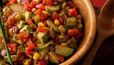 Avocado Salad: Fresh avocado, tomato, cucumber, and corn are tossed together to make a delicious, crisp salad. Quick and easy for a light lunch or alongside any meal.